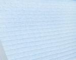 detail modré látkové žaluzie plisé