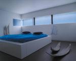 modrá látková žaluzie plisé v ložnici